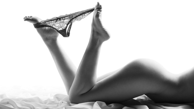 sexy naked ladies legs with pulled down panties, black white photo
